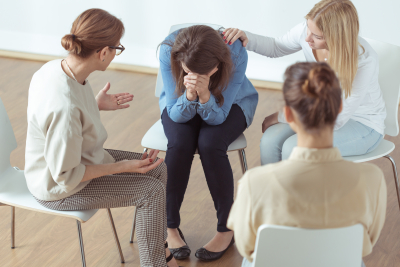 Young despair woman crying during group therapy